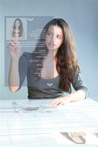 young beautiful businesswoman touching hi-tech business CV