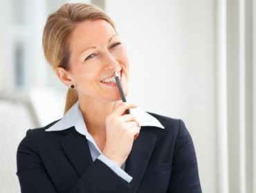 Portrait of smiling mature business woman looking at copyspace